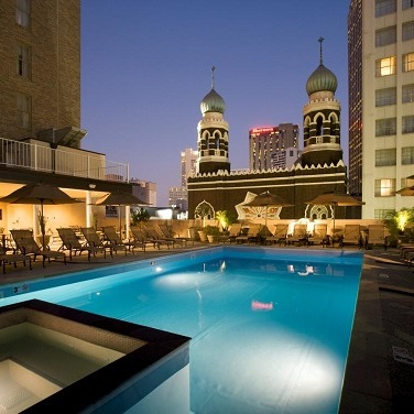 Roosevelt's rooftop pool and view of downtown at night